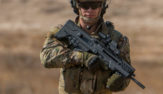Soldier holding a Tavor 7 Rifle